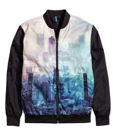 Pilot jacket with colorful photographic city design, stand-up collar, and side pockets.│ H&M Divided Guys