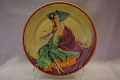 """Catalina Island Pottery cold painted plate -  Spanish dancer w/ fan over head, 14"""". This is a copy of the cover, Feb 1930, Saturday Evening Post, by McCelland Barclay. Also copied by Taylor Tile. Painted by Graham."""