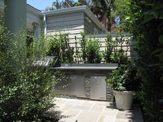 Built-in stone and stainless steel outdoor kitchen.