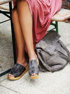 Free People Mare Slip On Clog at Free People Clothing Boutique - Spanish crafted flatform slides with distressed washed leather uppers and comfortable padded insoles. Grainy wooden bottoms.