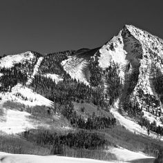 Day 1/1 for the #blackandwhitechallenge #BandW Thanks @14erskiers for the nomination! It only seems right to kick this off with a photo of #crestedbuttemountain #motherrock just taken with our new snow, to help increase #contrast! Photo:Chris Segal