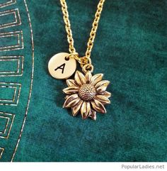 Nice gold necklace, flower and name