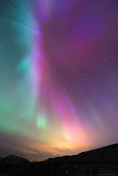 """Rainbow Auroras! Win! From Nat Geo -- 'A vibrant spectrum of color fills the sky above Tromsø, Norway, on September 26. """"We were lucky that we were able to find a place with clear sky around,"""" photographer Thilo Bubek told National Geographic News. """"First we saw some green auroras, but later we saw colors we had not seen this strong [in] the last years."""" '"""