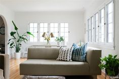 living room with white walls and natural light