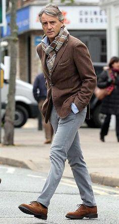 Shop this look on Lookastic: https://lookastic.com/men/looks/blazer-long-sleeve-shirt-chinos/13660 — Brown Plaid Scarf — Brown Wool Blazer — Light Blue Long Sleeve Shirt — Grey Chinos — Brown Suede Brogues