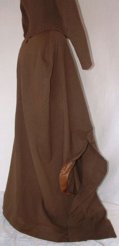 Side Saddle: The Brown 1880's Habit Good shot of the post-1875 safety skirt with its fall away slit. This is a safety skirt as opposed to a safety apron which wouldn't come about until the turn of the century.