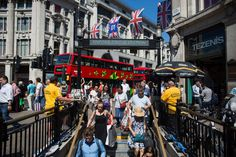 Pedestrians enter the London Underground at Oxford Circus in the U.K. capital's chief shopping precinct....