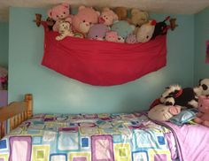 Sheet and curtain rod used for stuffed animal storage. Sheet and curtain rod used for stuffed animal storage. Sheet and curtain rod used for stuffed animal storage. Sheet and curtain rod use. Stuffed Animal Holder, Stuffed Animal Storage, Organizing Stuffed Animals, Sheet Curtains, Homemade Stuffed Animals, Indian Room, Pet Pigs, Toy Store, Girl Room
