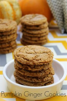 Pumpkin Ginger Cookies - Made with ginger, molasses, spices & fresh pumpkin these are one of the best ginger cookies ever. Nice and crispy on the outside, then soft and chewy on the inside.