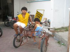 A traditional bike in the Philippines. Many families use this as their mode of transport if they can afford it. Many of the children we work with also work as pedal pushers, bringing passengers around the village.