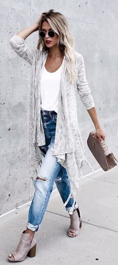 #winter #outfits women's space dye gray long cardigan, white top, blue faded distressed jeans, and gray suede open-toe heeled booties