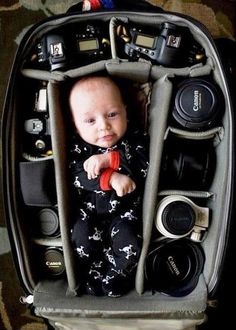 Cute idea for a photo Put all your babies into one camera backpack