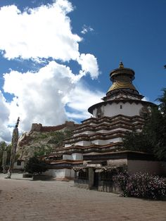 The Gyantse sacred area is dominated by the Kumbum; a stupa like image temple founded in 1427 that takes the form of a three dimensional mandala. Within the 77 small chambers that encircle the structure are many elaborate paintings and sculptures. As one walked around and up onto this structure the sacred imagery becomes increasingly complex and culminates in the upper chambers with a series of massive mandalas.