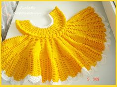 Click to view pattern for - Crochet delicate yellow dress for girl