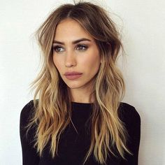#16: Long Beachy Hair - Layered Bronde Hairstyle Best for thin, layered hair, this bronde style is created with very subtle, narrow highlights. Notice, too, the middle part that draws attention to the face. Complete this look with a natural lip, a light-brushed brow, and an under-eyeliner.