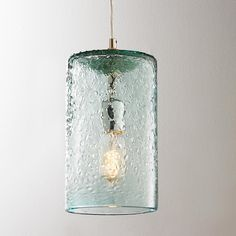 Pebbled Glass Cylinder Pendant Clear tinted pebbled glass provides texture and interest. Available in Sky Blue, Clear and Lime. Glass Pendant Shades, Glass Pendant Light, Glass Pendants, Pendant Lights, Pendant Lamps, Kitchen Island Lighting, Kitchen Pendant Lighting, Kitchen Pendants, Strip Lighting