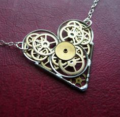 clockwork heart necklace <3 so cool, I love jewelry made out of old watch gears!
