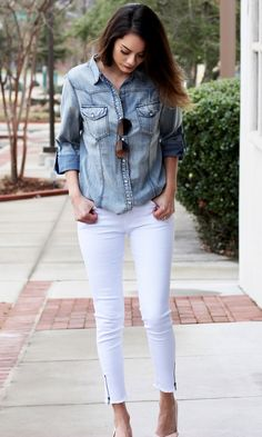 This is a lightweight denim shirt with pearlized buttons. This top looks perfect tucked into our White Zipper Jeans. - Lightwash - Rolled up 3/4 length sleeves - Fits true to size - Serena is wearing size medium