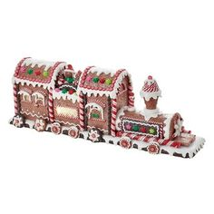 Add a fun, classic touch to your holiday dcor with this Battery-Operated Gingerbread LED Train Tablepiece from Kurt Adler. This train is festively decorated with gingerbread and candy-inspired d Gingerbread Train, Gingerbread Village, Gingerbread Decorations, Christmas Gingerbread House, Christmas Table Decorations, Christmas Treats, Christmas Cookies, Holiday Centerpieces, Gingerbread Cookies