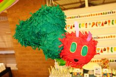 Pinata at a Very Hungry Caterpillar party!  See more party ideas at CatchMyParty.com!  #partyideas #veryhungrycaterpillar