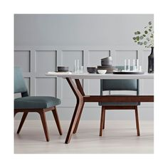 Bring a mod twist to your dining room with the Holmdel Dining Chair from Project 62™. Made from solid wood so that it's sturdy and durable, this mid-century modern dining chair features an easy armless design that works great at the dining table. The foam-filled seat provides extra comfort so your family and guests stay comfortable through dessert. <br><br>1962 was a big year. Modernist design hit its peak and moved into homes across the country. And in Minnesota, Tar...