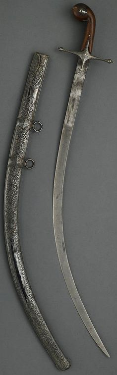 Ottoman kalij,18th or early 19th century, blade of watered steel. Silver crossguard chased with florals. Hilt with gripscales of translucent brown horn, the bulbous pommel pierced for a lanyard and set with boteh-shaped silver panels; engraved silver spine. Scabbard fully sheathed in silver and decorated overall with chased repousse panels of floral meander and repeating designs within various borders. 34 inch blade.