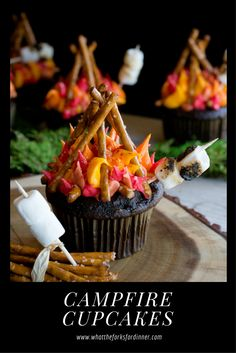 Campfire Cupcakes - Cute cupcakes for all campers. Your favorite cupcake flavor decorated with flames, pretzel logs, and toasty mini marshmallows! Too cute!
