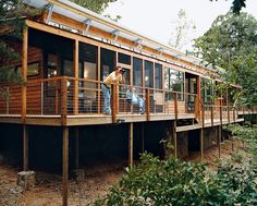 Kiesling House: Jelle birdwatches while Eileen rests on the deck.  Photo by: Daniel Hennessy      Read more: http://www.dwell.com/slideshows/part-of-the-plan.html?slide=4=y=true##ixzz1xoNVAfKw