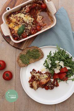 Een heerlijke Italiaanse ovenschotel, deze Italiaanse kip uit de oven met tomatensaus.