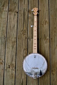 Love this idea, the picture on the face of the banjo... I can't play, but sure would love to hang this baby someplace here...