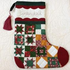 This stocking will make Grandad's Christmas! It features embroidery, applique and a variety of pieced blocks. Pattern available at www.magicpatchquilting.com.au