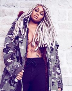 Blac Chyna rocks blonde dreads and puts her boobs on display