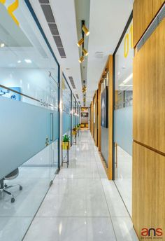 Contemporary Co Working Space with Optimum Use of Natural Light | ANS Design House - The Architects Diary Led Light Fittings, Grey Floor Tiles, Suspended Lighting, Open Office, White Ceiling, Modular Furniture, Coworking Space, Common Area, Office Interiors
