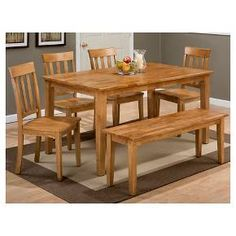 • Crafted from solid wood <br>• Classic silhouette <br>• Recessed panels<br>• Square, tapered legs<br>• Seats up to 6 comfortably<br><br>The Simplicity Rectangle Dining Table from Jofran combines a classic silhouette with sturdy construction and high-quality materials to create a casual piece your entire family can gather around. Its simply style is an easy fit with a variety of decor.