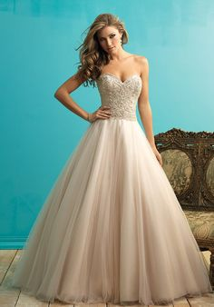This gown is the dreamy essence of a ballgown, with layers and layers of English net composing the skirt.