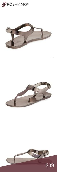 """MICHAEL Michael Kors Plate Jelly Sandal 8 Ⓜ️ MICHAEL Michael Kors metallic jelly sandal. Gunmetal color - gunmetal logo plate at instep. Brand never never been worn. Will ship with the box. 0.5"""" flat heel.  Thong strap connects to adjustable ankle strap.  Metallic footbed.  Synthetic sole.  Comes from a pet/smoke free home. Also on Ⓜ️. MICHAEL Michael Kors Shoes Sandals"""