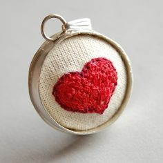 embroidered heart pendant