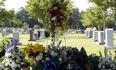 Flowers cover the grave of Cooper Harris in Tuscaloosa, Alabama