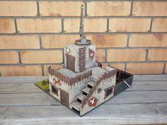 http://battle40k.blogspot.fr/2011/04/ork-mek-shop-terrain.html