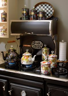 Flower Market tea kettles blowing off some steam.