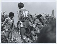 Football players smoke a cigarette during the warming-up. Australia, c. 1983