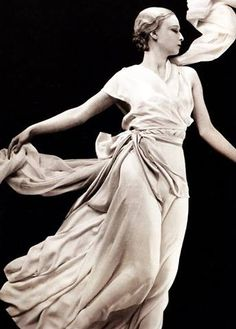 Model is wearing pale crepe romain pajamas by Madeleine Vionnet and holding a long flowing scarf, in Grecian-style pose photographer George Hoyningen-Huene. Elsa Schiaparelli, Madeleine Vionnet, Paolo Roversi, Peter Lindbergh, Sarah Moon, Diana Vreeland, John Galliano, Carmen Dell'orefice, Vintage Outfits