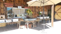 Fun western props and twig raw wood top tables make a great country buffet. Vintage fruit boxes  are used for chafing dishes.