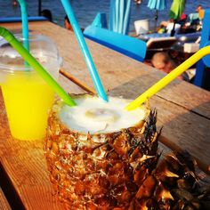 Real pineapple juice inside real pineapple. #pineapple #juice #pineapplejuice #cool #cocktail #straw #straws #color #colors #brightcolors #turquoise #green #yellow #beach #beachlife #Halkidiki #Greece #blue #summer #summermood #holiday #holidays #vacation #sea #sun #afternoon #umbrellas #relax #instalike