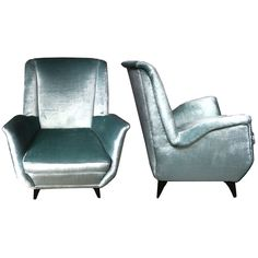 Imposing Pair of Italian 1950s Armchairs in the Manner of Ponti  Italy  50's  Imposing and comfortable pair of armchairs in the manner of Ponti having a close resemblance to the Ponti armchairs for the Bristol Hotel. Wide open armrests, beautiful wood legs, re-upholstered in light blue velvet, new seat cushions.  Serch word: lounge chairs, club chairs