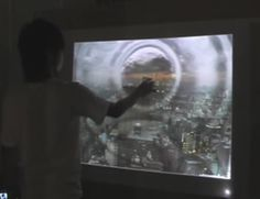 An interactive art installation allowing people to distort time in a video with touch. Interactive Board, Interactive Installation, Interactive Design, Installation Art, Leap Motion, Circle Infographic, Video Lighting, Future Trends, Art And Technology