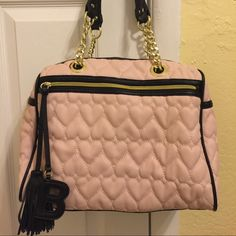 Betsey Johnson purse Pink,Gold and Black exterior. Two zippers. Black inside with writing. Betsey Johnson Bags Shoulder Bags