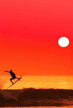 Sunset Surfing  //  For premium canvas prints and posters check us out at http://palaceprints.com/go/1/