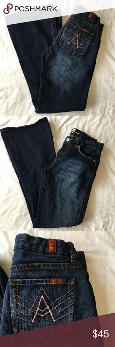 7 For All Mankind Pink A Pocket Flare Blue Jeans Very cute dark wash Flare jeans. Back pockets have pink stitching in the shape of an A. 100% cotton. Great used condition. Live long and poshper 🖖🏼 7 For All Mankind Jeans Flare & Wide Leg