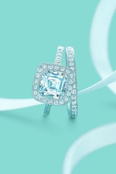 Tiffany's cushion cut fancy wedding engagement ring with a matching diamond wedding band